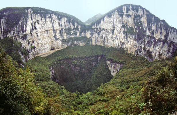 This limestone feature is a large sinkhole known as the Xiaozhai Tiankeng